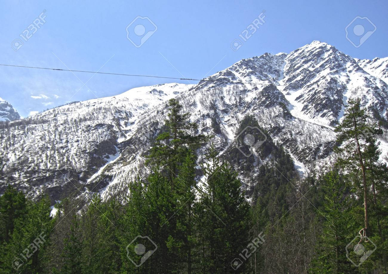 Caucasus mountains under the snow and clear sky Stock Photo - 11473901
