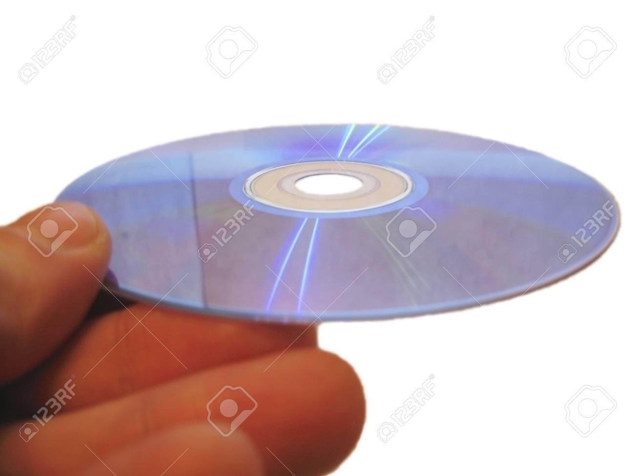 Compact disk and male finger isolated on the white background Stock Photo - 13606055