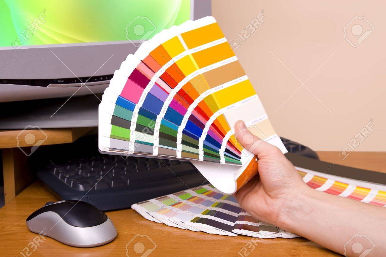 Designer at work. Color samples on table. Stock Photo - 10687228