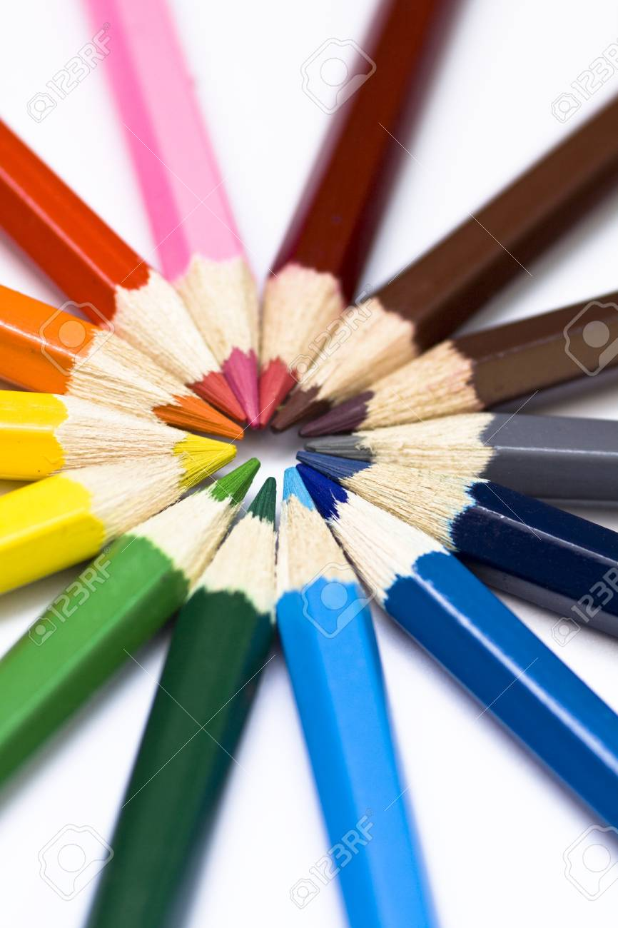 Close-up of a selection of colored pencil crayons, arranged like a color wheel. Stock Photo - 10744448