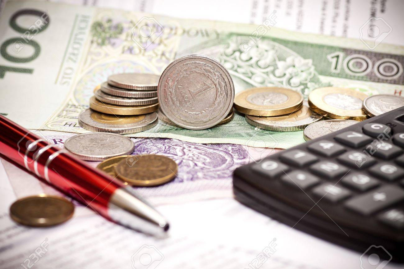 Money coins, calculator on the polish banknotes Stock Photo - 12054920
