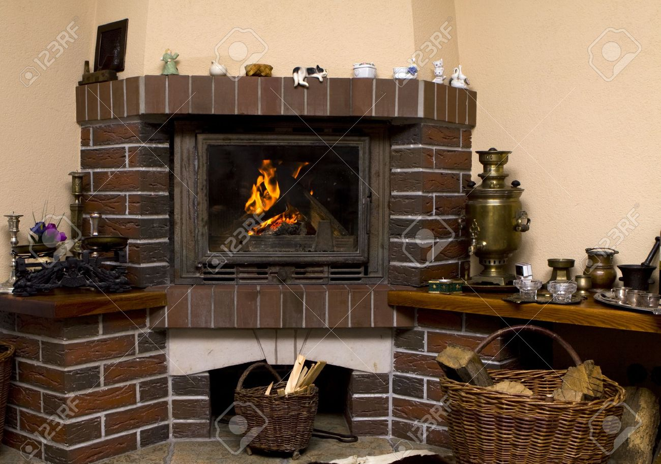 wood fire in an old style wooden log cabin stock photo picture