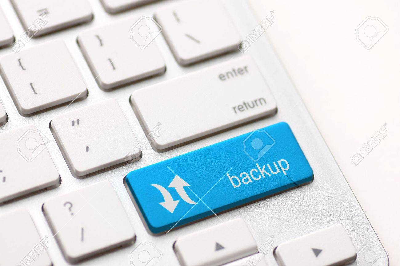 Backup Computer Key In blue For Archiving And Storage Stock Photo - 20401106