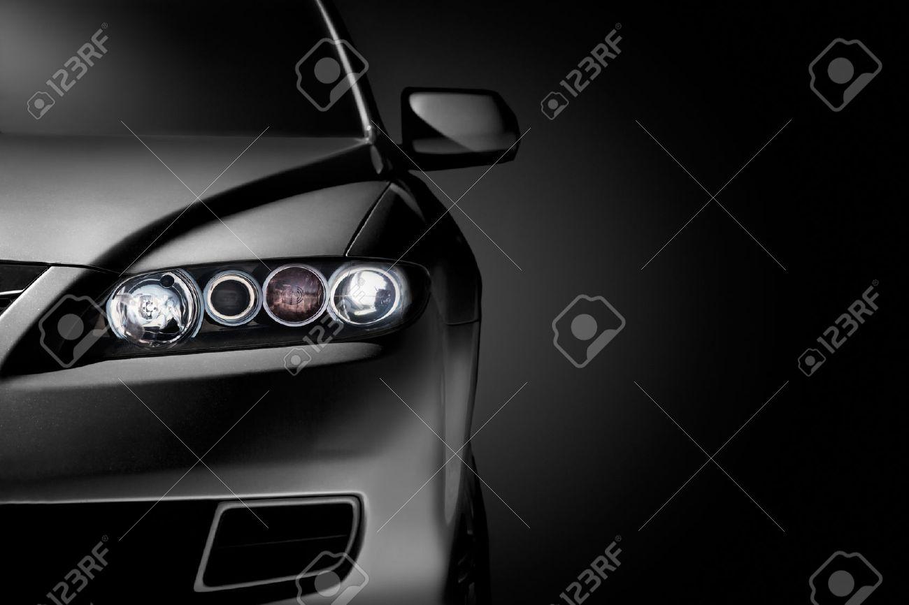 Gray modern car closeup on black background - 27356807