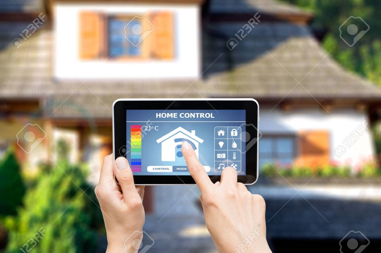 Remote home control system on a digital tablet or phone. Stock Photo - 42356382