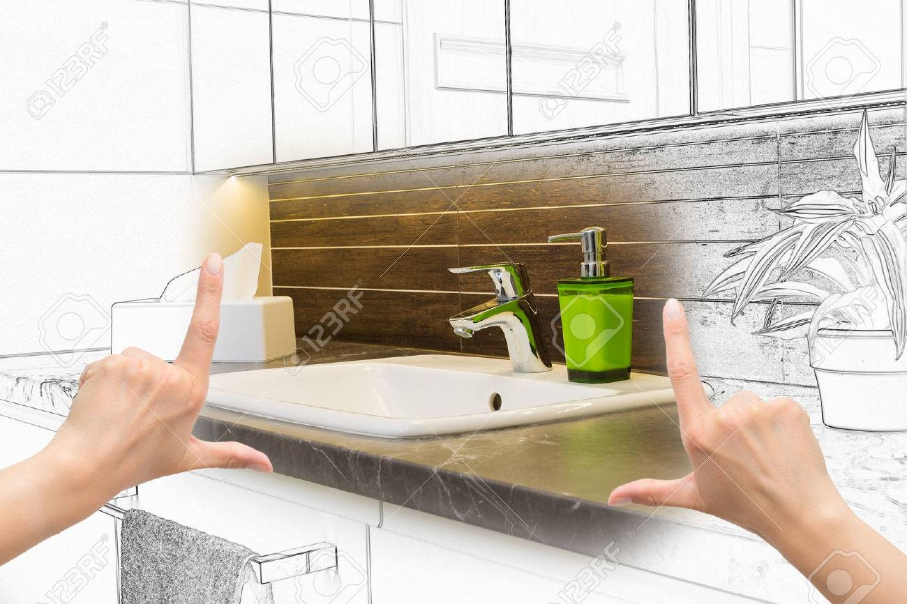 female hands framing custom bathroom design. combination drawing