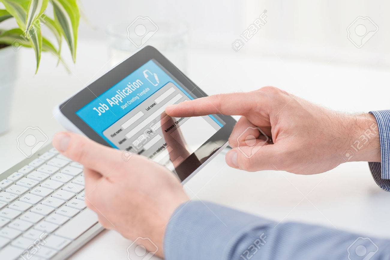 applicant filling up the online job application by digital tablet applicant filling up the online job application by digital tablet stock photo 44883358