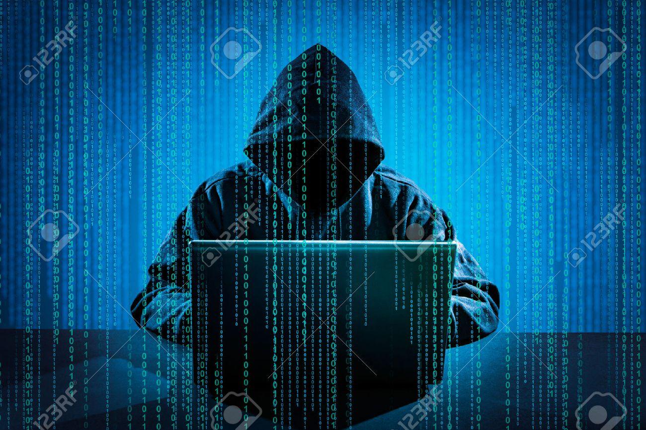 Hacker using laptop. Hacking the Internet. Banque d'images - 55613469