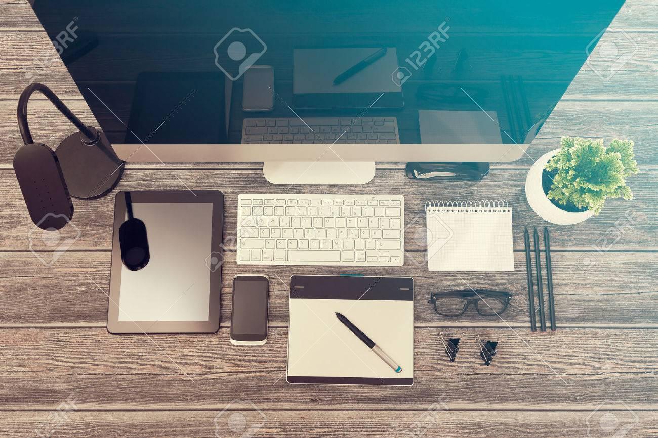Designer's desk with responsive design mockup concept. Stock Photo - 56962892