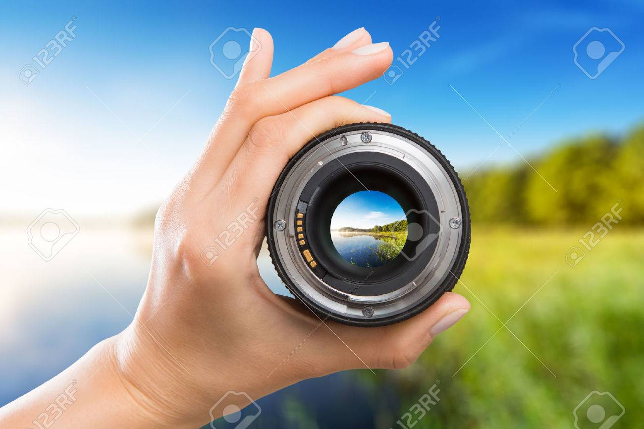 photography view camera photographer lens lense through video photo digital glass hand blurred focus people concept - stock image Stock Photo - 64976808