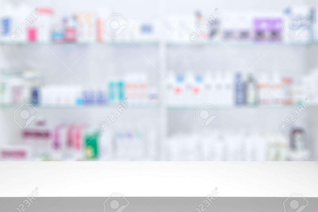 counter store table pharmacy background shelf blurred blur focus drug medical shop drugstore medication blank medicine pharmaceutics concept - stock image Banque d'images - 64976883
