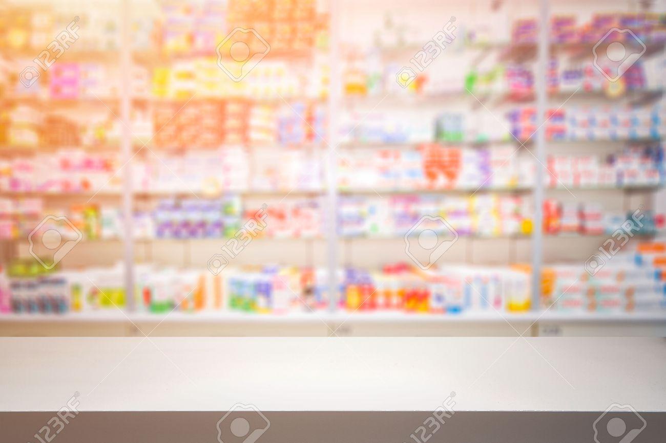 counter store table pharmacy background shelf blurred blur focus drug medical shop drugstore medication blank medicine pharmaceutics concept - stock image Stock Photo - 64977759