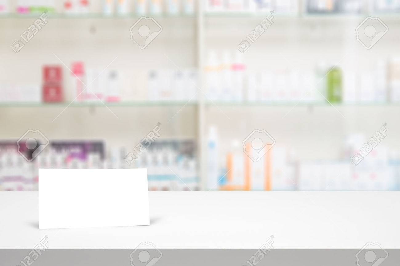 counter blank background white store medical table pharmacy business shelf blurred drug shop drugstore medication card concept - stock image - 64977758