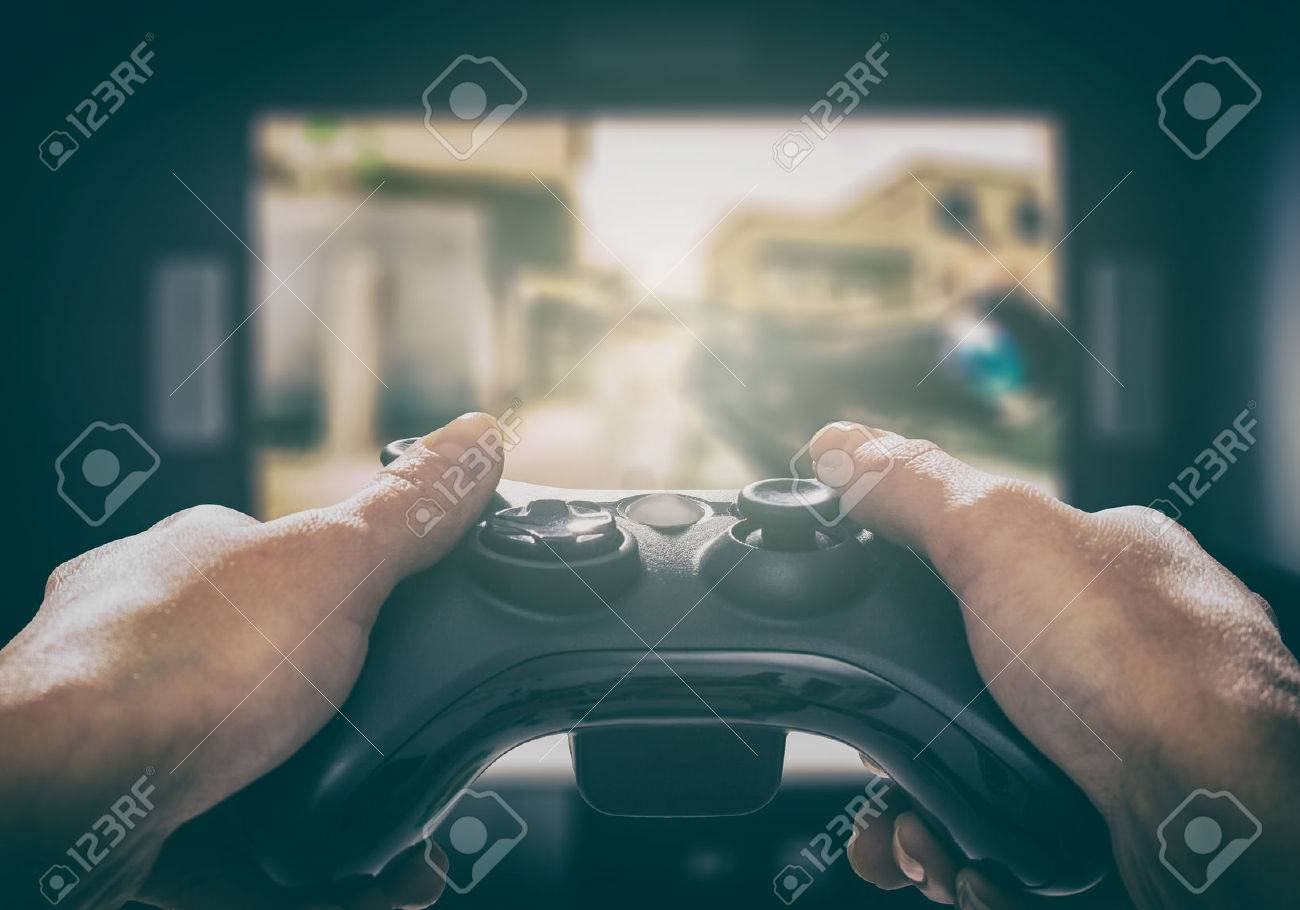 gaming game play tv fun gamer gamepad guy controller video console playing player holding hobby playful enjoyment view concept - stock image Stock Photo - 72092285