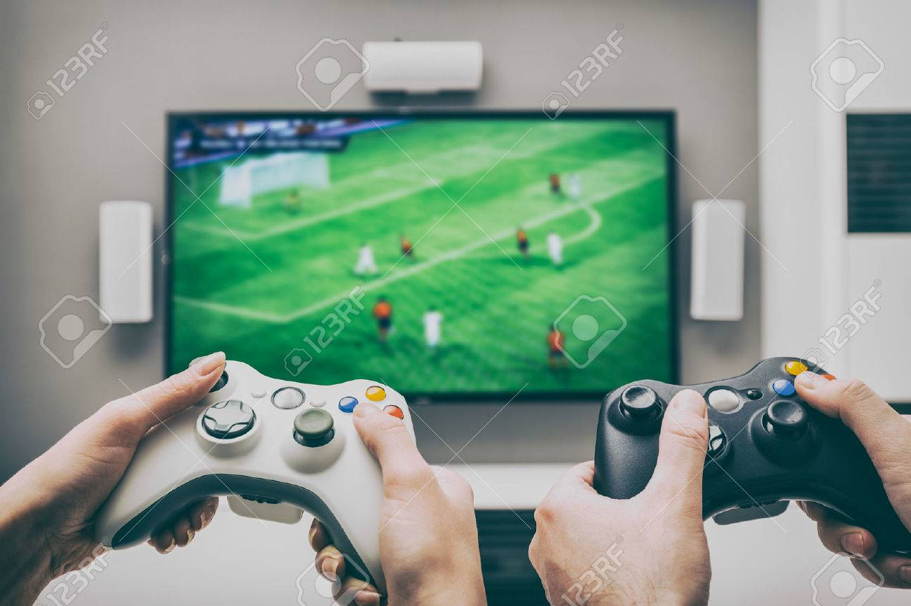 gaming game play tv fun gamer gamepad guy controller video console playing player holding hobby playful enjoyment view concept - stock image Stock Photo - 73651069