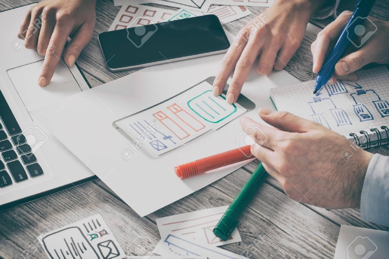 ux designer designing designers web brand phone smartphone layout geek business prototype internet goals sketch plan write idea success solution concept - stock image Stock Photo - 74151888