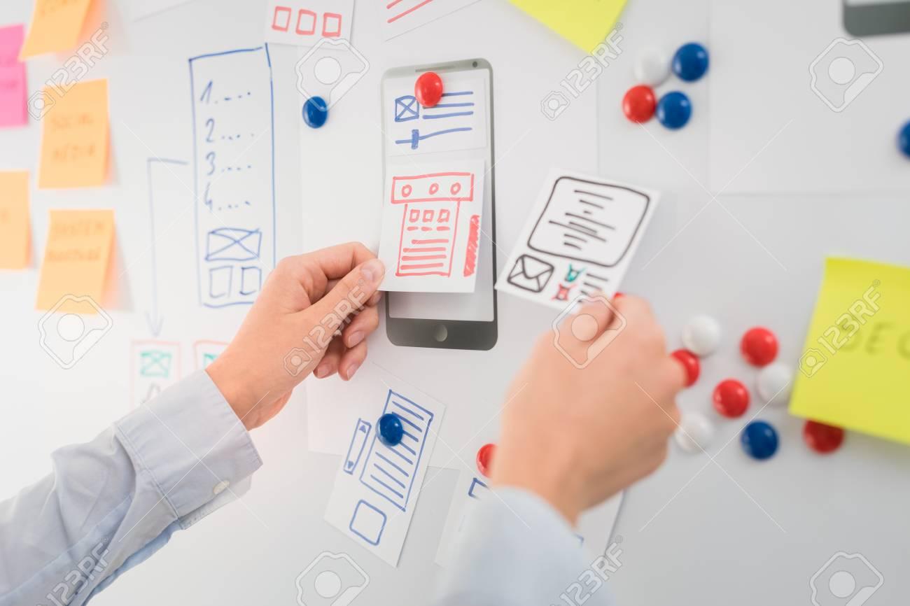 Designer woman drawing website ux app development. User experience concept. - 84412930