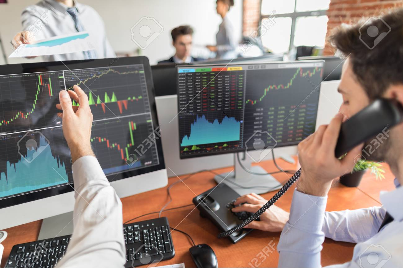 Business team investment trading do this deal on a stock exchange. People working in the office. - 89697279