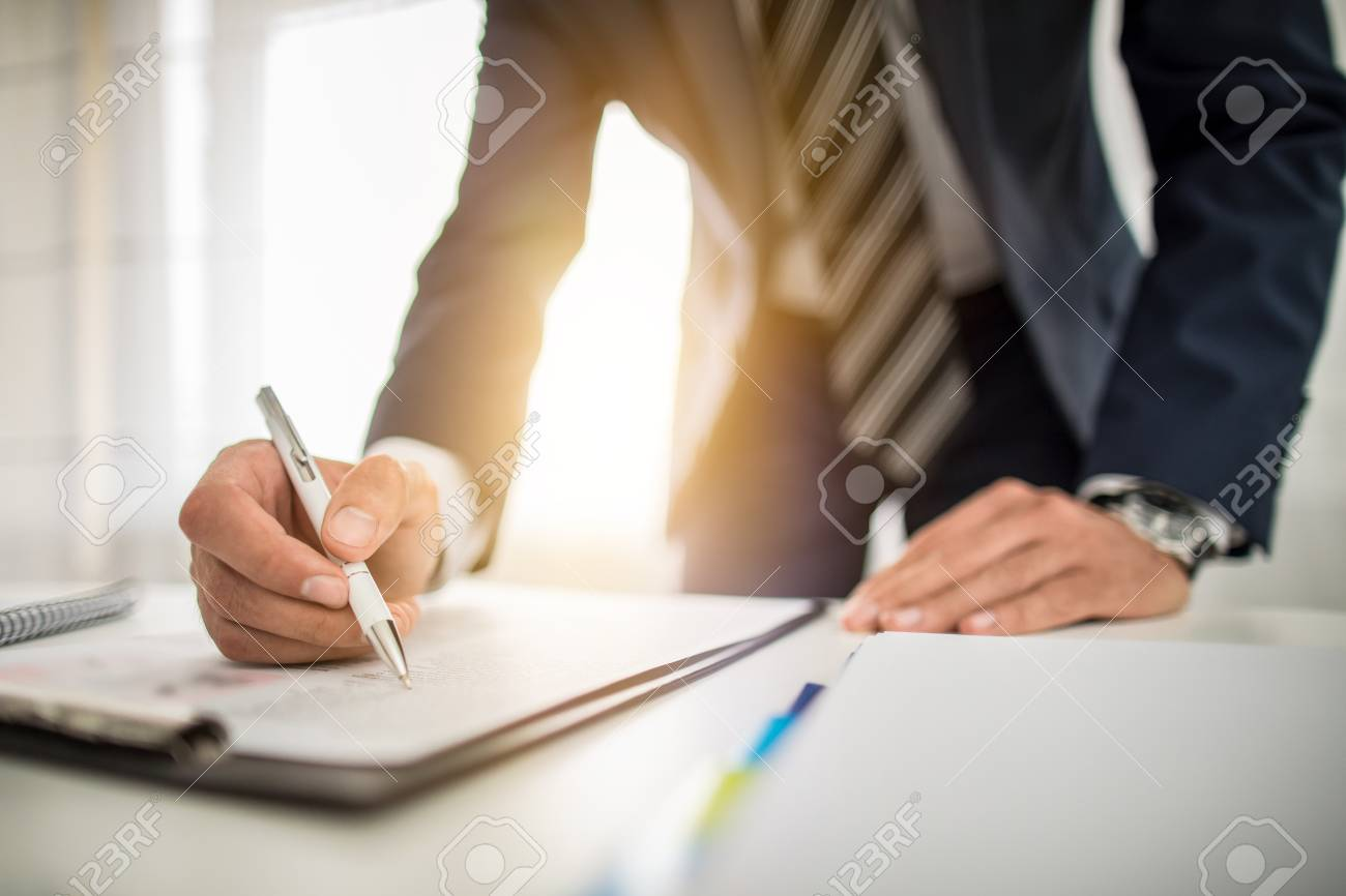Business man signing contract document on office desk, making a deal. - 89642871