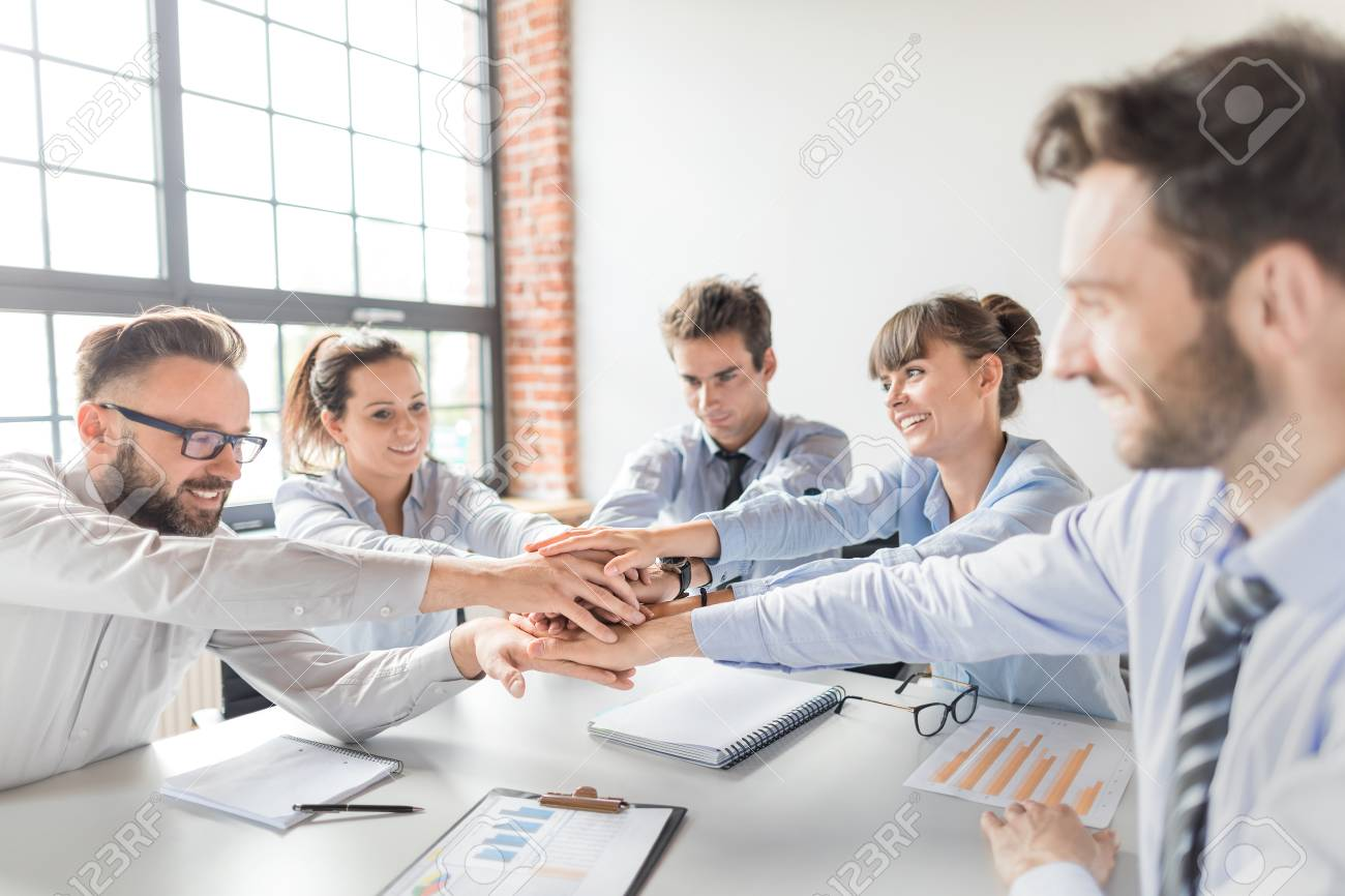 Close up top view of young business people putting their hands together. Stack of hands. Unity and teamwork concept. - 89225188