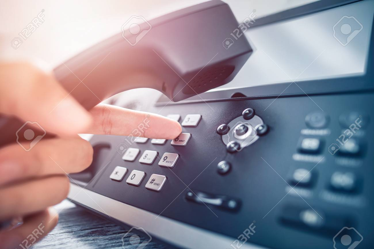 Communication support, call center and customer service help desk. Using a telephone keypad. - 92919818