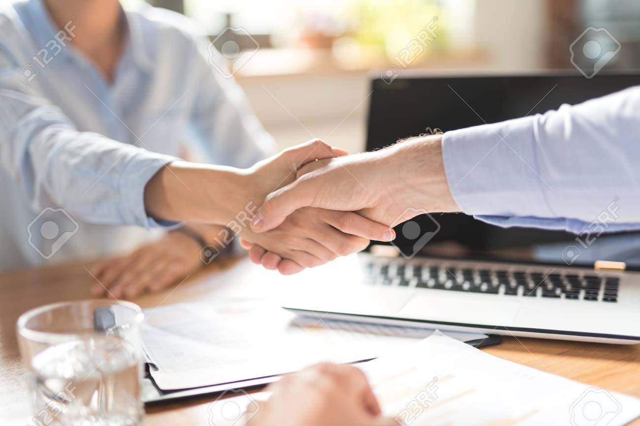 Business people shaking hands, finishing up meeting. Successful businessmen handshaking after good deal. - 92911015