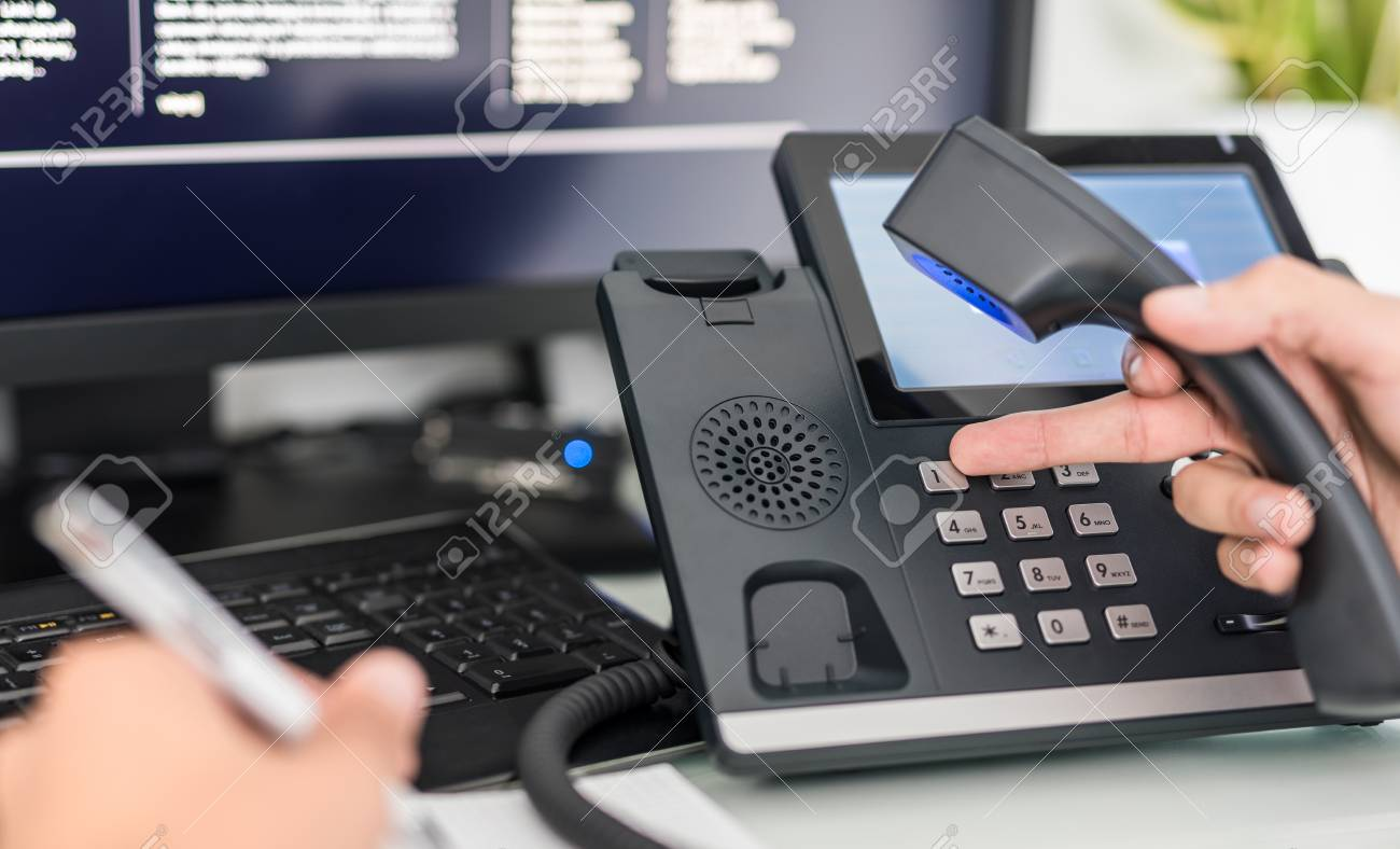 Communication support, call center and customer service help desk. VOIP headset on laptop computer keyboard. - 92990694