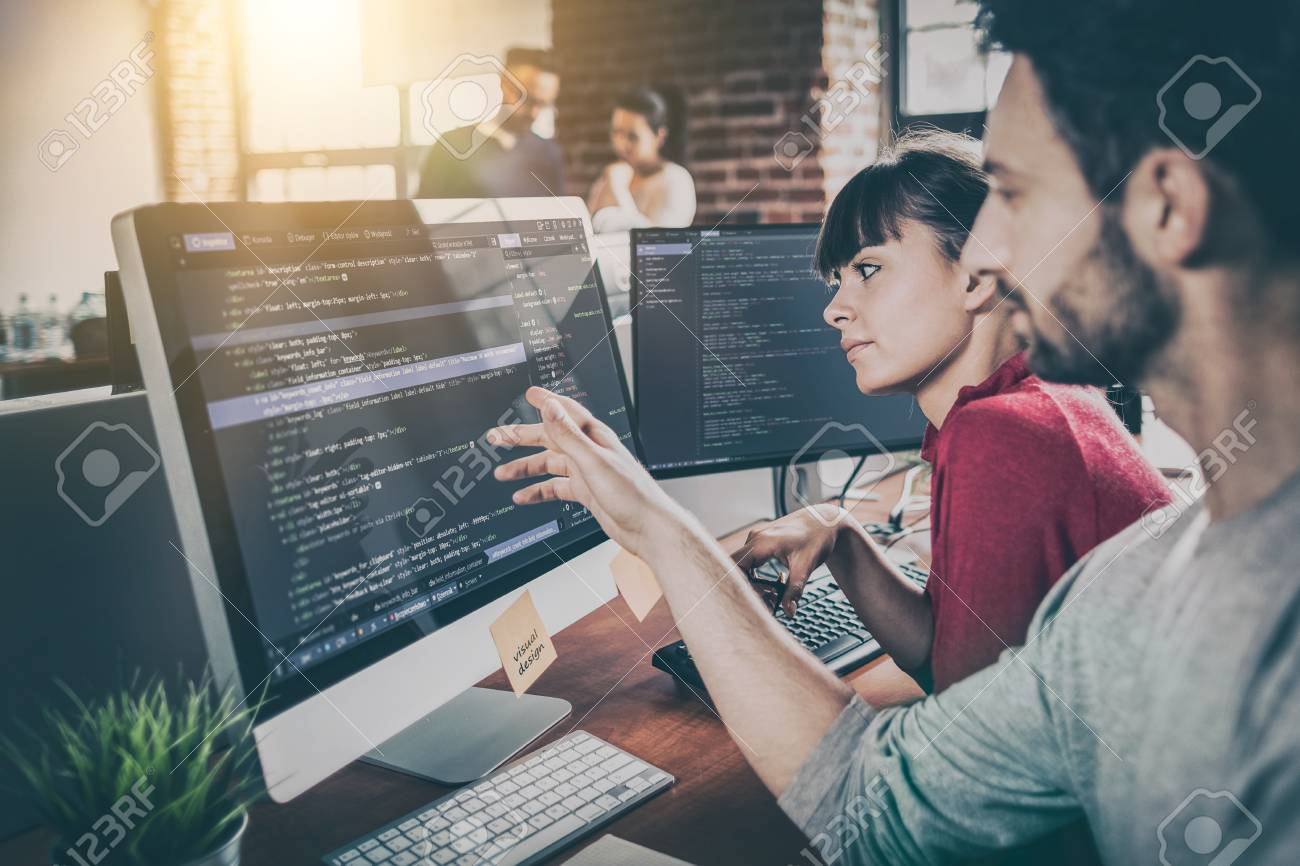 Developing programming and coding technologies. Website design. Programmer working in a software develop company office. - 96050752