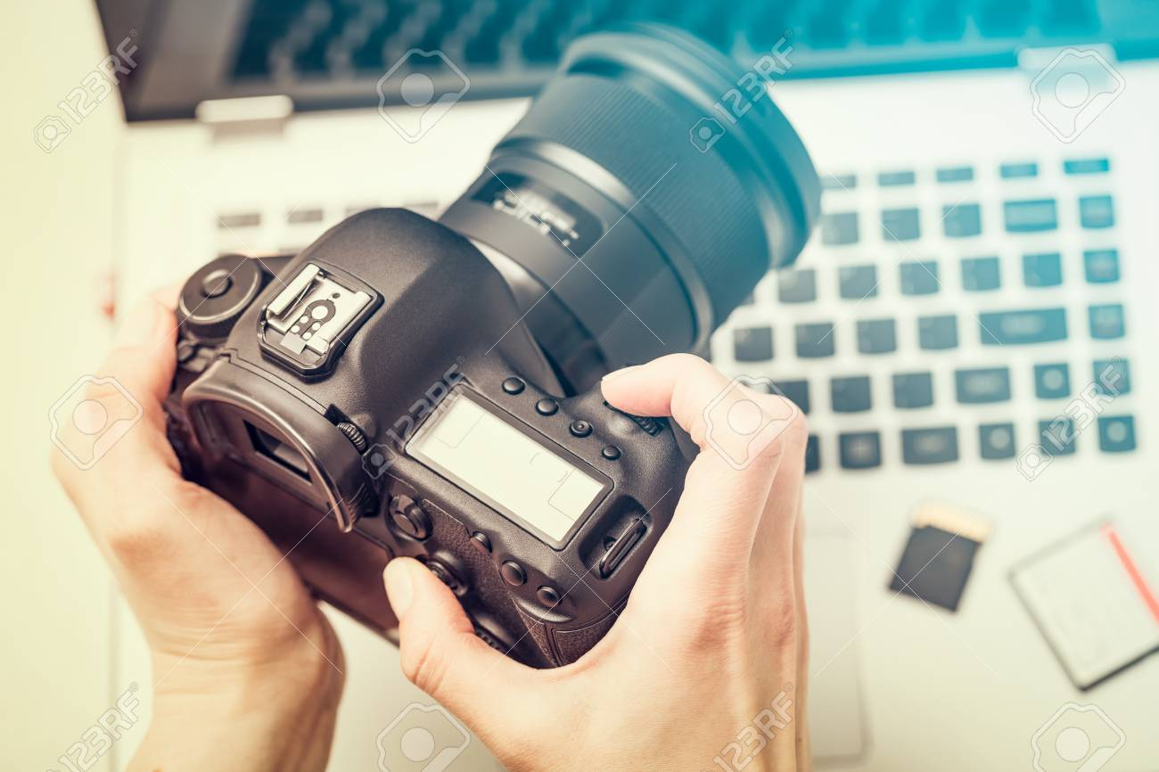 Modern digital DSLR camera and computer workstation. Photography and videography concept. - 96039521