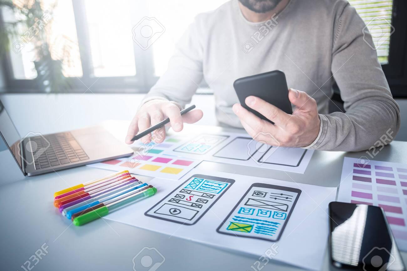 Designers man drawing website ux app development. User experience concept. - 132370205