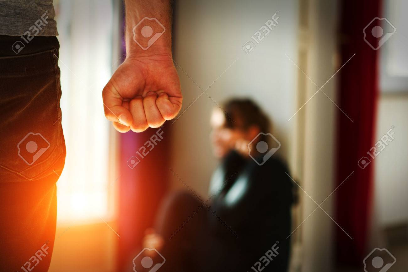 Man beating up his wife illustrating domestic violence - 51187929