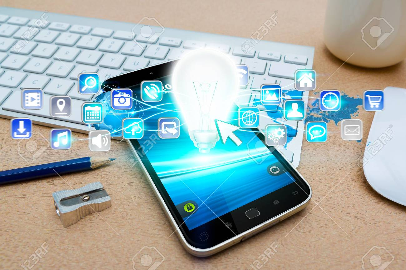 Modern mobile phone in office with lightbulb and digital icons flying over - 51961043