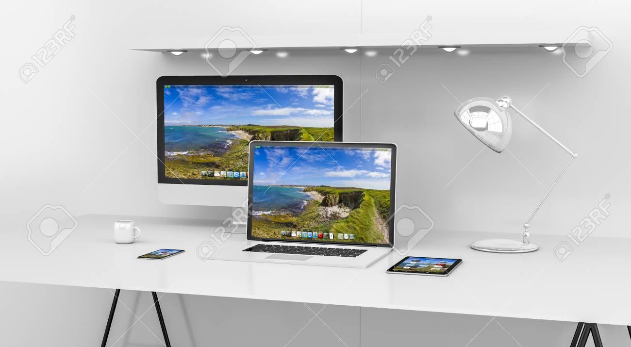 Intérieur moderne de bureau blanc avec ordinateur et appareils
