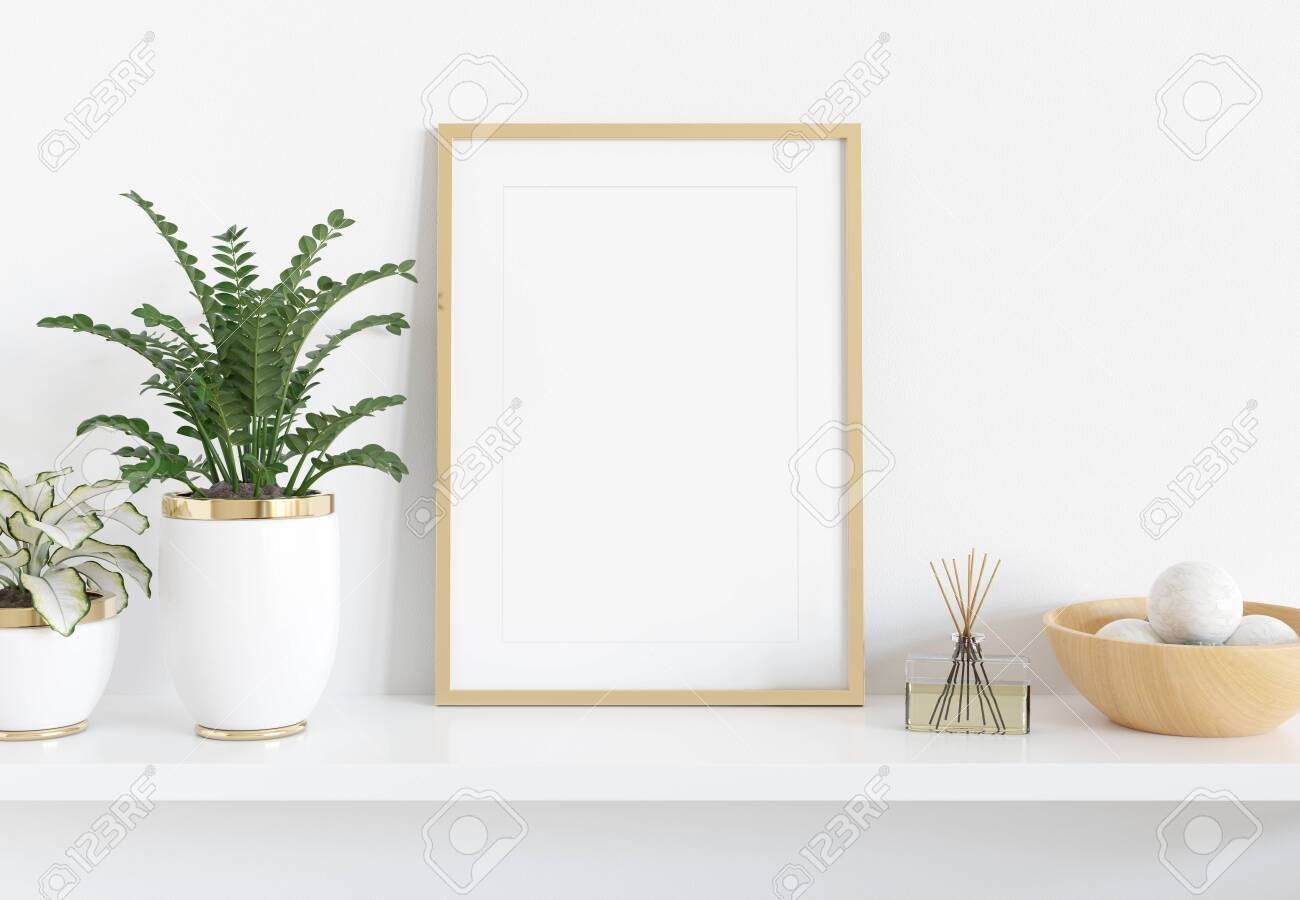 Golden frame leaning on white shelve in bright interior with plants and decorations mockup 3D rendering - 124578153