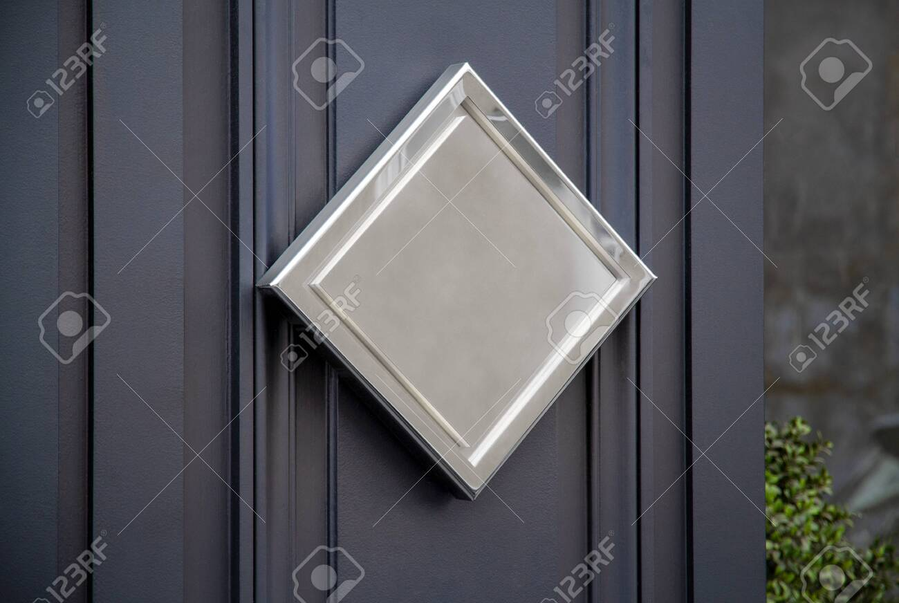Metallic diamond sign on hotel door mockup. Golden plate on storefront wall in street - 150516843