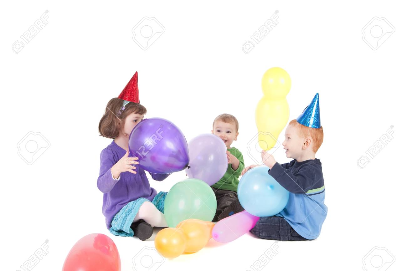Three kids playing with balloons at party Stock Photo - 7369036