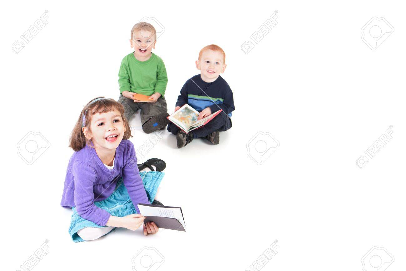 Three happy kids reading books and looking up. Isolated on white with shadows. - 7440745