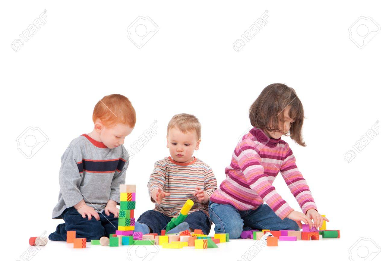 Three kids playing with wooden blocks. Isolated on white, with shadows. - 7596254
