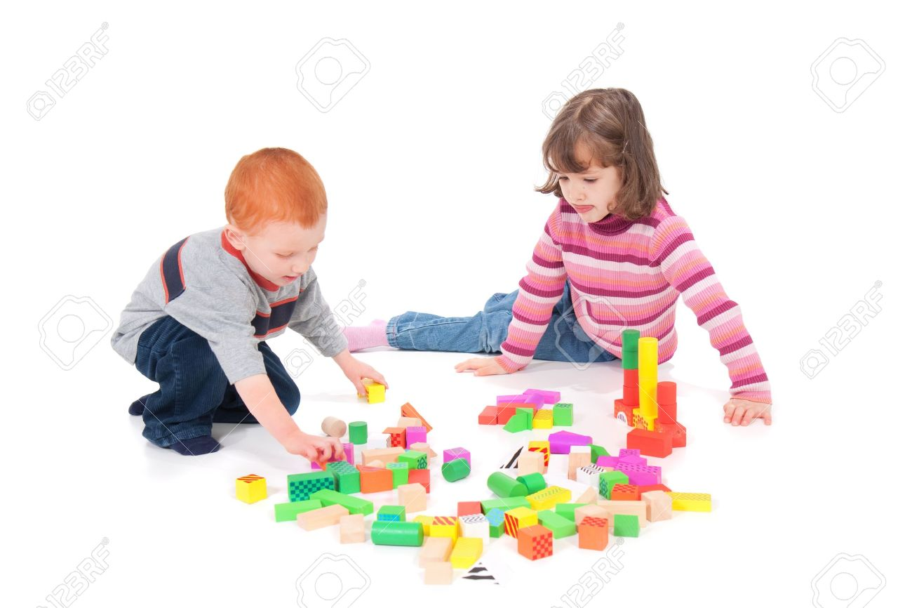 Two kids playing with colorful blocks. Isolated on white with shadows. - 7596253