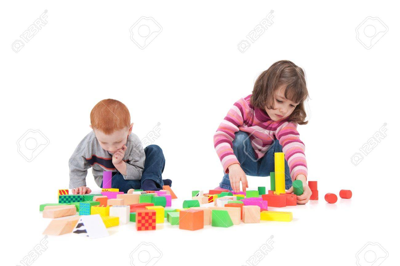 Two kids building block towers. Isolated on white with shadows - 7596243