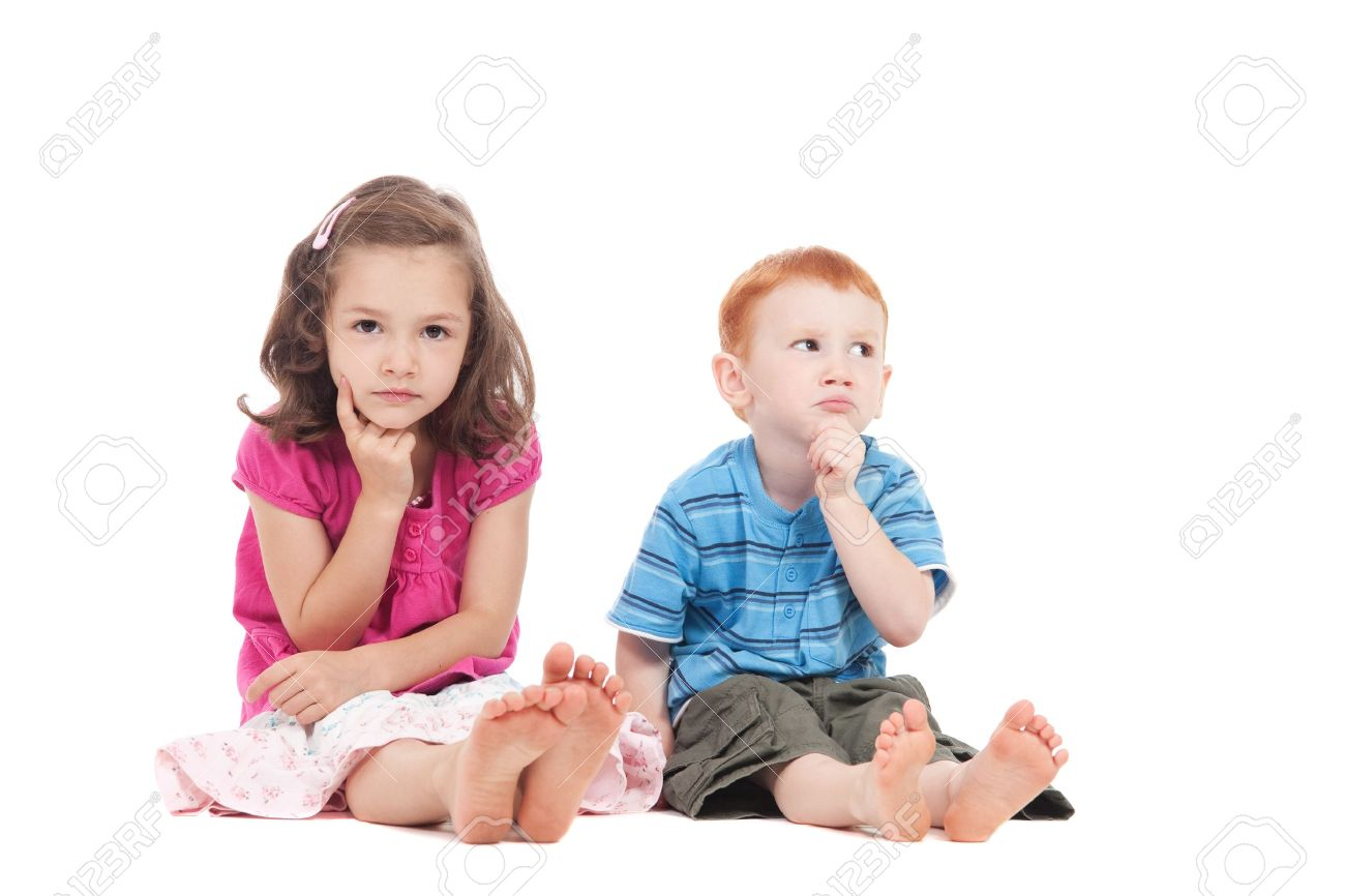 Two kids sitting on floor with thinking expression. Isolated on white. Stock Photo - 8927169