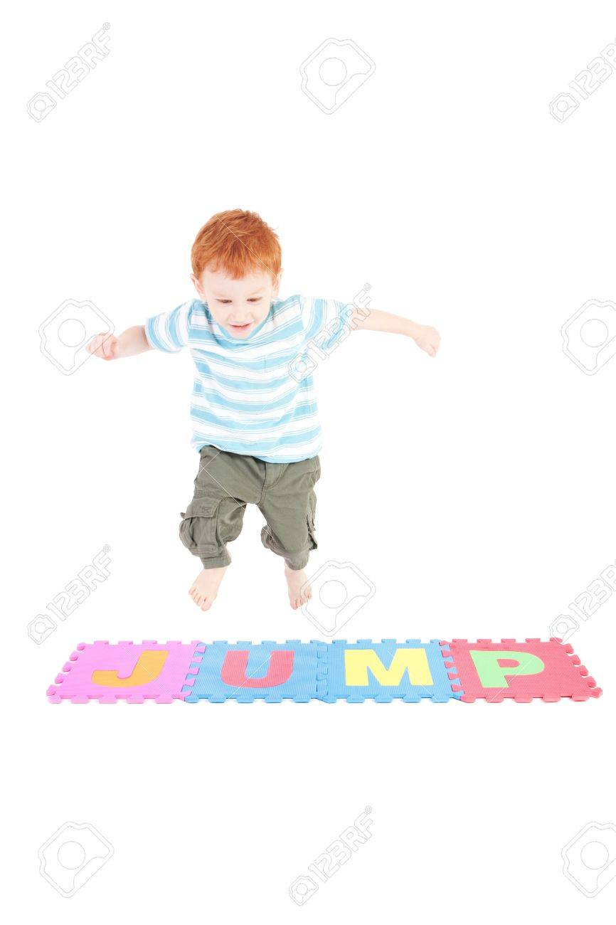 Young boy jumping over word jump. Isolated on white. - 8927156