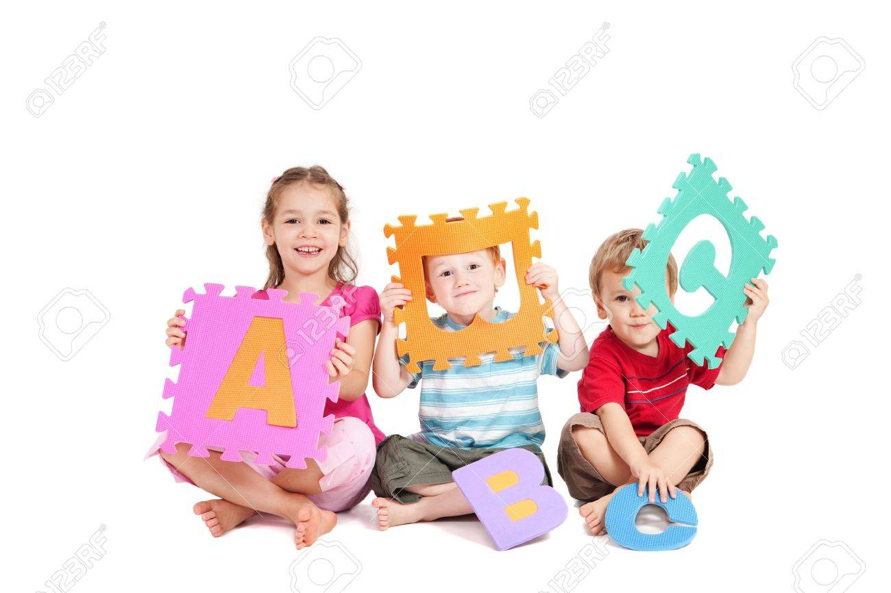 Three kids having fun learning with alphabet ABC letters. Isolated on white. - 9080042