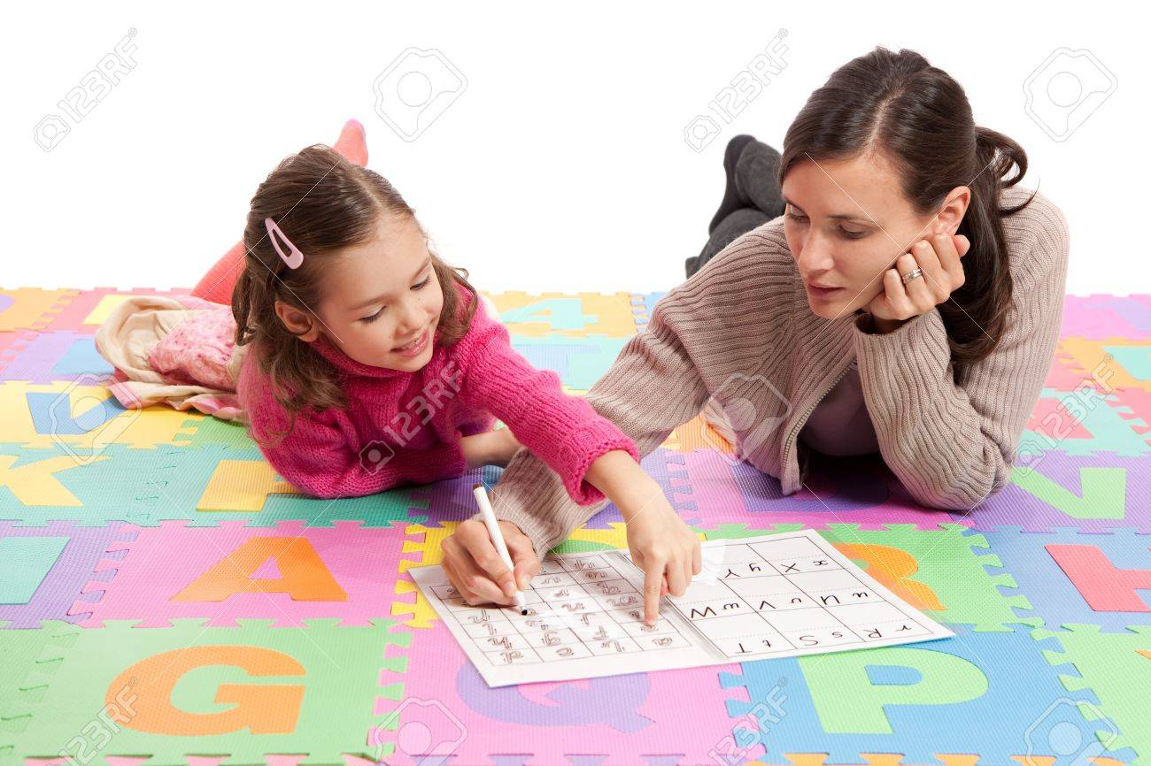 Girl learning handwriting practice from teacher. Isolated on white. - 9334525