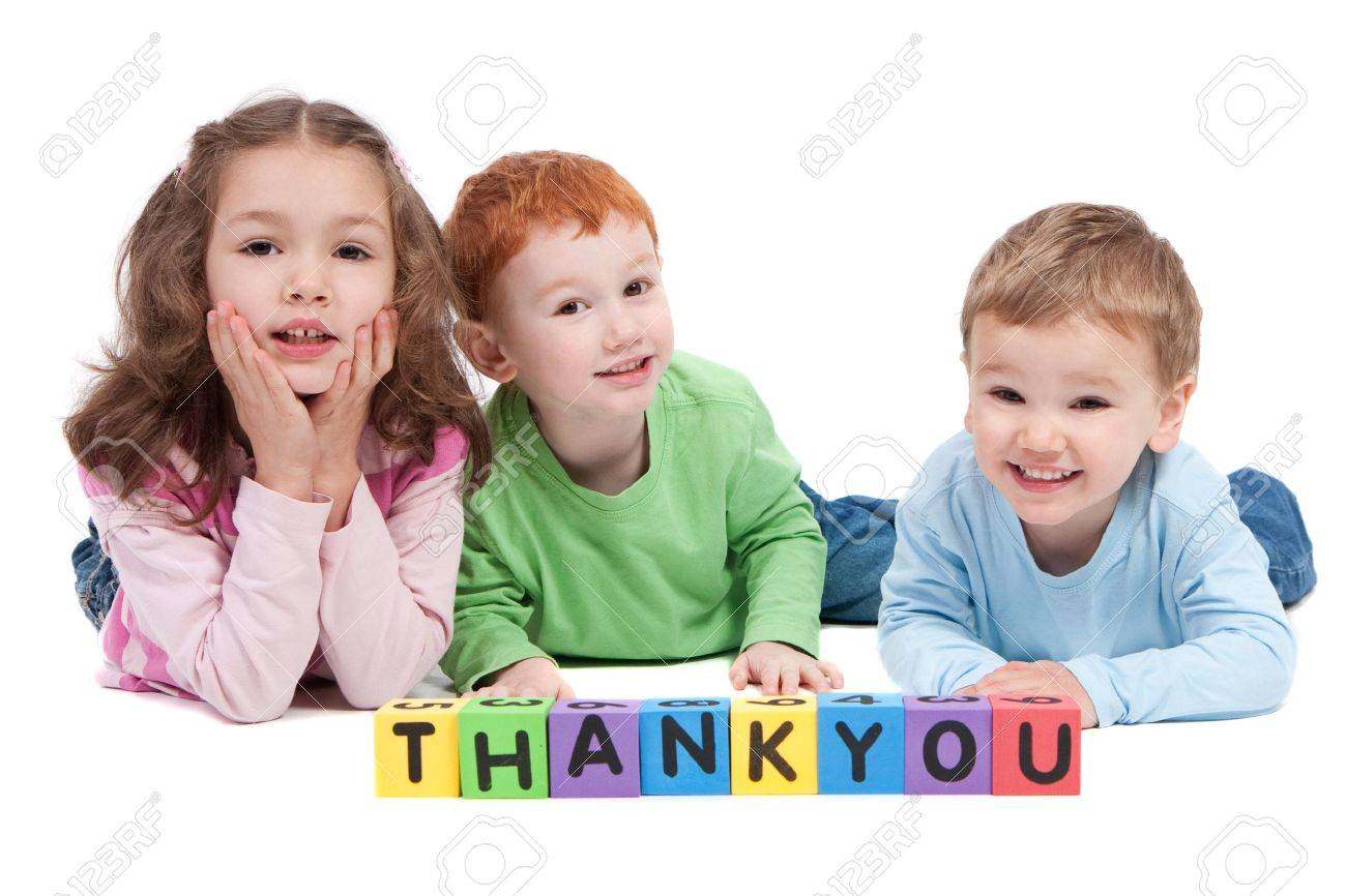 Three children lying with saying thankyou with kids letter blocks. Isolated on white. - 9699040