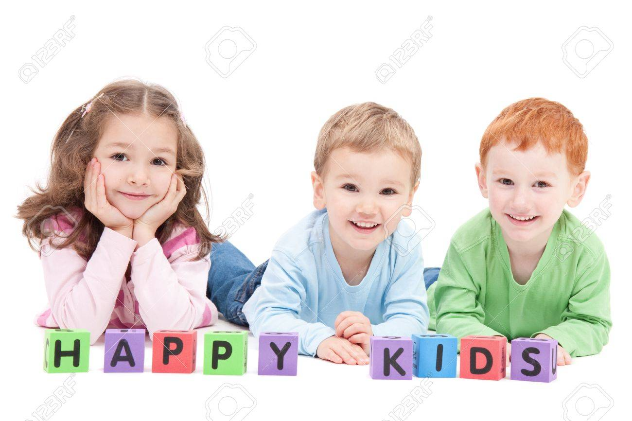 Three happy children with kids blocks. Isolated on white. - 9699039