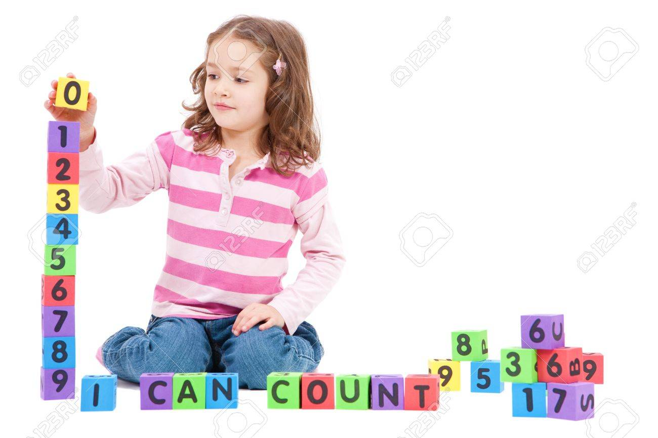 Girl counting numbers with blocks and saying I can count. Isolated on White - 9820758