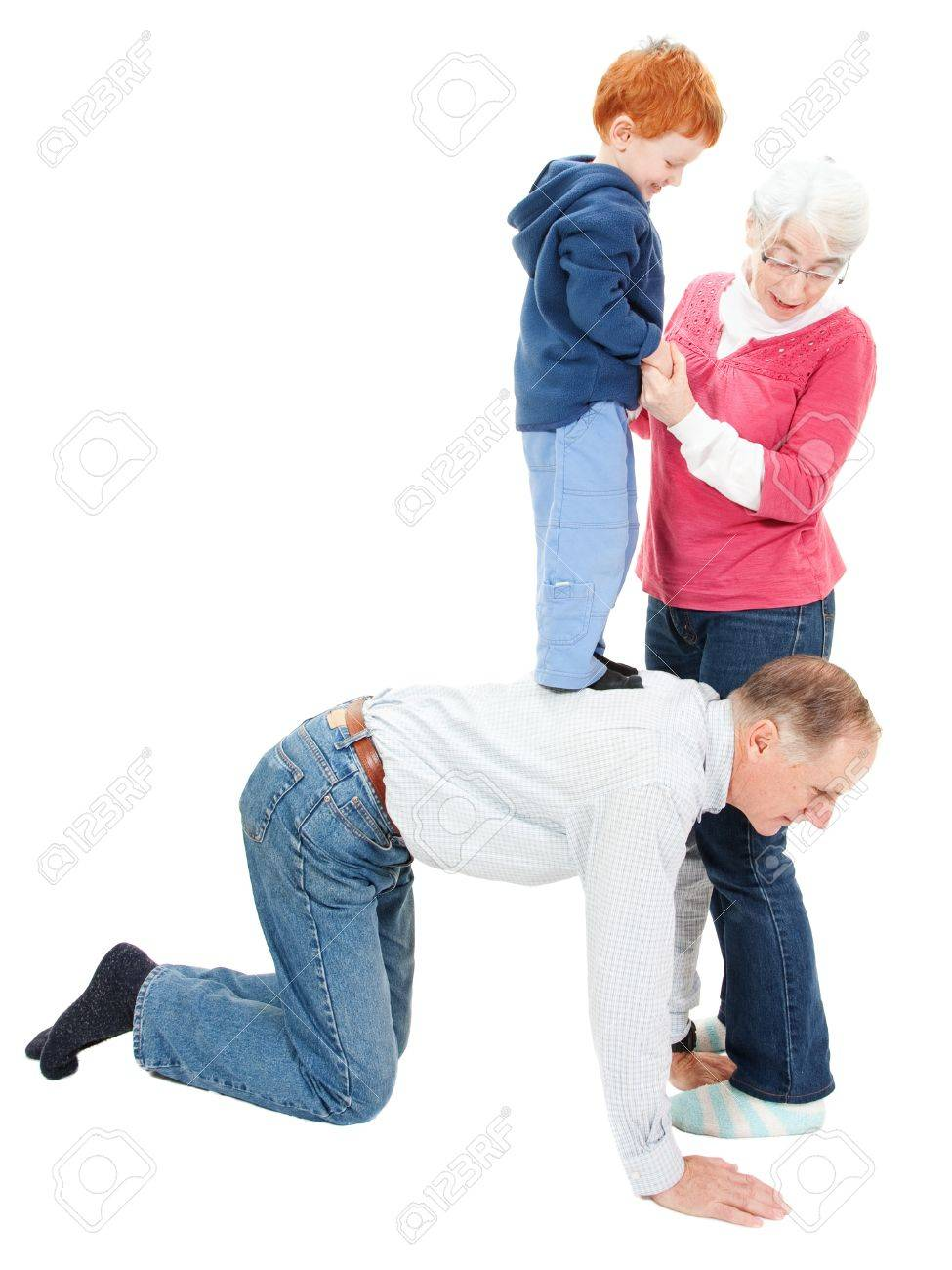 Grandmother and grandfather having fun playing with boy grandchild. Isolated on white. - 10656680