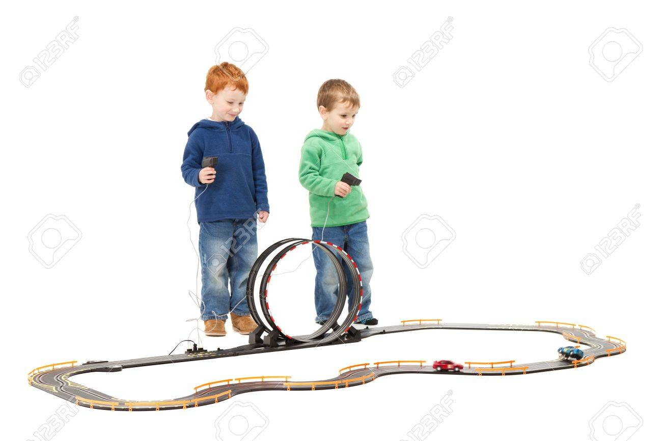 children playing kids racing toy electric slot car game on white stock photo 15155170