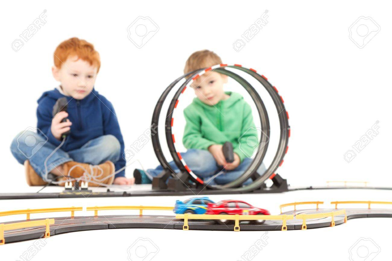 Children playing kids racing toy electric slot car game On white - 15155175